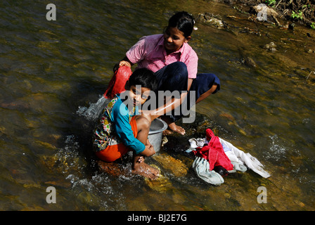 karen lady washing clothes , mae la  refugee camp(thai burmese border) , north of mae sot , tak province , north - Stock Photo