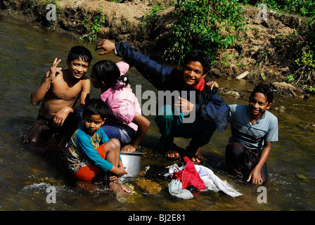 karen family washing clothes,mae la  refugee camp(thai burmese border) , north of mae sot , tak province , north - Stock Photo