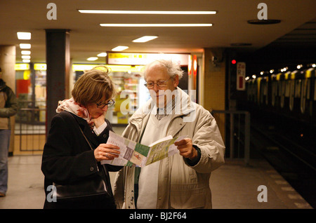 Passengers at an underground station - Stock Photo