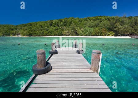 jetty on Manukan island in Sabah Borneo Malaysia with its turquoise water, green vegetation and white sand beaches - Stock Photo