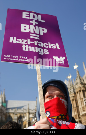 A Unite Against Fascism supporter protests against the English Defence League in London, 05/03/2010. - Stock Photo
