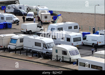 Travellers set up an illegal camp on a public car park at black rock next to brighton marina - Stock Photo