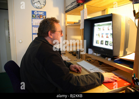 Freelance photographer in his office, Berlin, Germany - Stock Photo