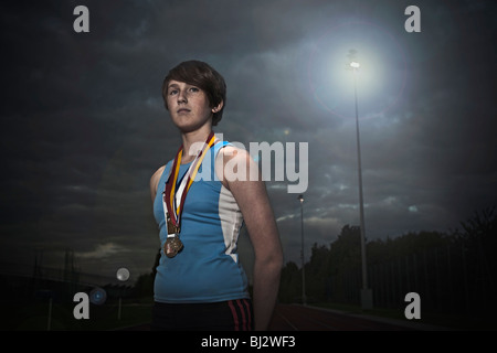female athlete with medals - Stock Photo