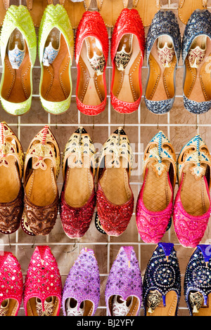 Fancy traditional Arabian slippers on display at a market stall in a souk in Deira, Dubai, UAE - Stock Photo