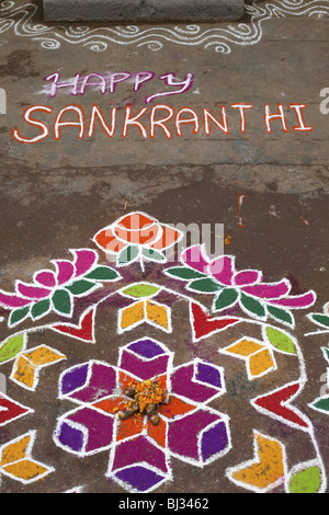 Rangoli festival designs in an Indian street made at the Hindu festival of Sankranthi or Pongal. - Stock Photo