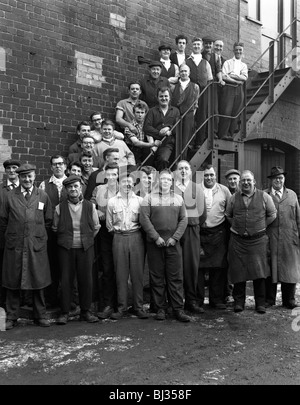 Group portrait of workers, Edgar Allen's steel foundry, Sheffield, South Yorkshire, 1963. Artist: Michael Walters - Stock Photo