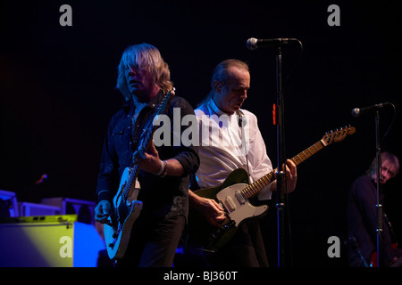 Rick Parfitt (left) and Francis Rossi (white shirt) of the rock bank Status Quo play electric guitars on stage during - Stock Photo