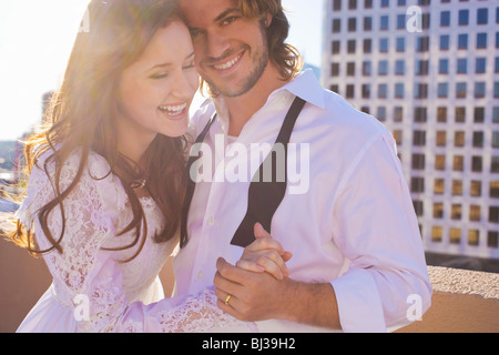 bride and groom on roof top in city - Stock Photo
