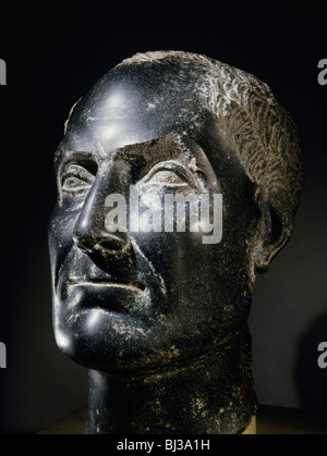 Schist portrait head from a statue of Penemerit, Ancient Egyptian, Ptolemaic period, 80-54 BC. Artist: Werner Forman - Stock Photo