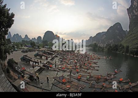 Sunset and bamboo rafting on Yulong river, Yangshuo - Stock Photo
