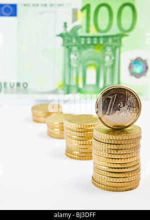 Euro and 50 euro cent coins, 100 euro bill - Stock Photo