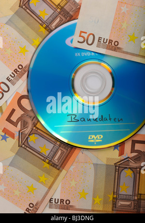DVD, CD, euro bills, symbolic image for the purchase of bank records, tax evasion, privacy - Stock Photo