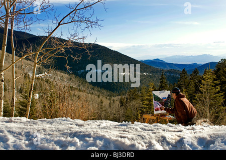 Male artist painting landscape picture outdoors in mountains near Santa Fe NM - Stock Photo