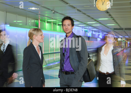 business couple at airport - Stock Photo