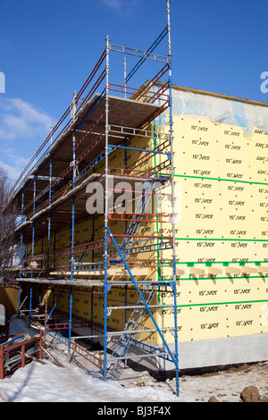 Scaffolding at construction site where the outer wall insulation plates are being installed , Finland - Stock Photo