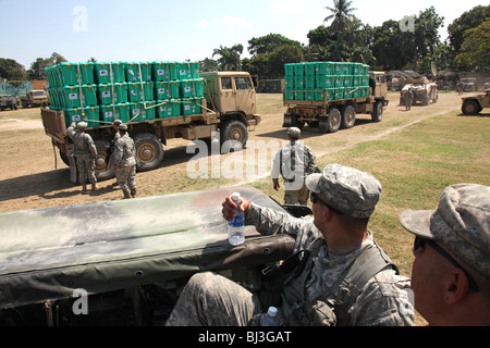 Soldiers of the 82nd Airborne, US Army distribute aid in Port au Prince, Haiti following the earthquake of January - Stock Photo