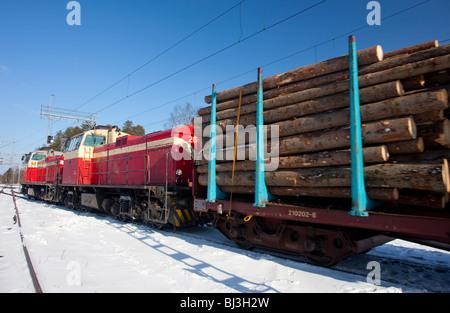 Old Finnish diesel electric locomotives ( type dv12 made by Valmet Lokomo ) on railroad yard pulling full load of - Stock Photo