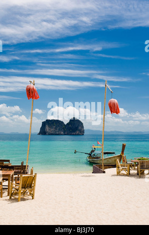 Tables and lanterns on the sandy beach, Mayalay Resort, Ko Hai or Koh Ngai island, Trang, Thailand, Asia - Stock Photo