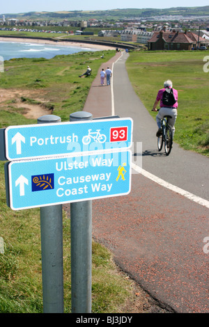 Cyclist on cycle route 93, Portrush, County Antrim, Northern Ireland - Stock Photo
