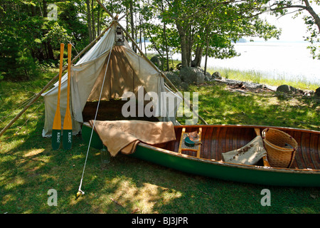 An historical campsite with tent and canoe from the early 1900s in Kejimkujik National park and National Historic - Stock Photo
