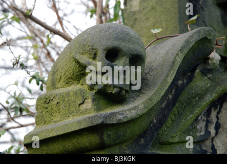 Skull, part of a headstone in Old Calton Burial Ground, Edinburgh, Scotland. - Stock Photo