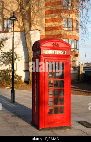 British red telephone box (k2) on the north bank of the Thames - Stock Photo