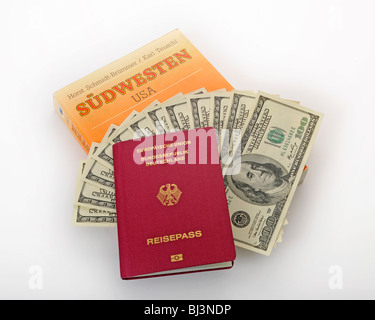 Travel Guide USA, Southwest, German passport, several 100-dollar bills - Stock Photo