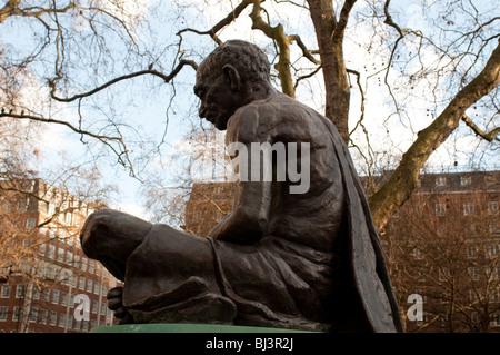 Statue of Mahatma Gandhi in Tavistock Square Gardens, Bloomsbury, Camden, London, UK - Stock Photo