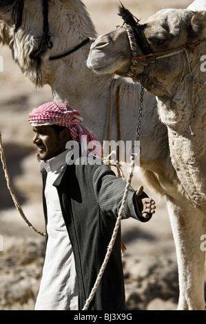 Nomad Bedouins of Sinai peninsula in Egypt on a camel Safari in Jebel Gunah area - Stock Photo