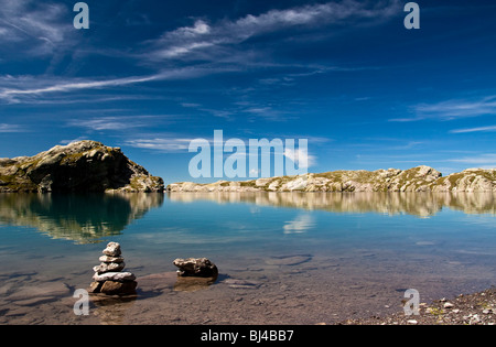 Cairns in the Schottensee lake below the Pizol massif, Bad Ragaz, Heidi country, Canton St. Gallen, Switzerland, - Stock Photo
