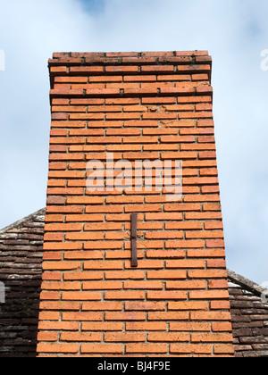 Decorative letter 'I' reinforcing chimney stack - France. - Stock Photo