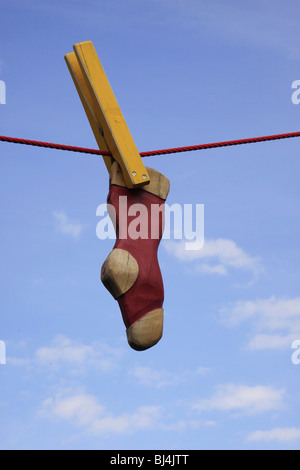 Sock on a clothesline, wood, horticultural show Saxony, 2009, Reichenbach, Saxony, Germany, Europe - Stock Photo
