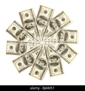 Artistic pattern made from dollar bills Snowflake or star Isolated with a clipping path on white background - Stock Photo