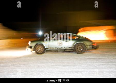 Porsche 911 Carrera 3.0, built in 1977, night race, Winter Raid 2010 classic car rally, Switzerland - Stock Photo