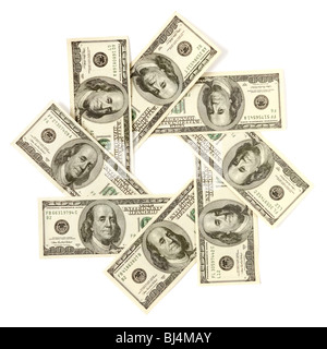 Artistic pattern made from dollar bills Snowflake star or aperture Isolated with a clipping path on white background - Stock Photo