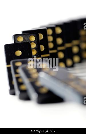 Falling dominoes, domino effect - Stock Photo