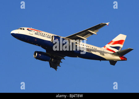 Airbus A319 operated by British Airways climbing out from take off at London Heathrow Airport - Stock Photo