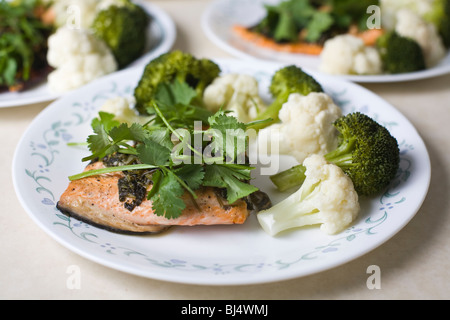 Gourmet meal of grilled salmon, broccoli, and cauliflower. - Stock Photo