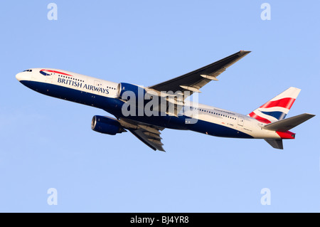 Boeing 777 operated by British Airways climbing out from take off at London Heathrow Airport - Stock Photo
