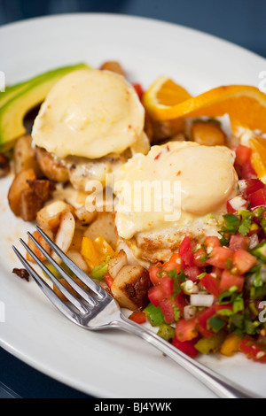 poached eggs, Dungeness crab cakes, chipotle Hollandaise sauce, roasted potatoes, Boathouse at Hendry's Beach, Santa - Stock Photo