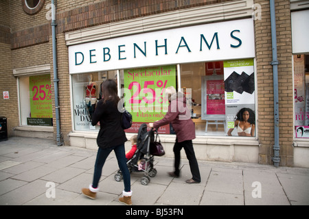 Debenhams shop exterior with shoppers looking in window - Stock Photo