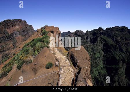 View of the Madeira's mountains near Pico do Ariero. Walking path leading from Pico do Ariero to Pico Ruivo. - Stock Photo