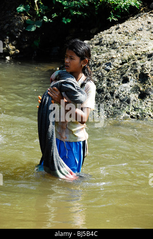 karen girl washing clothes in stream ,mae la  refugee camp(thai burmese border) ,north of mae sot,thailand - Stock Photo