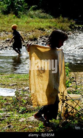 karen burmese children washing clothes in stream,mae la  refugee camp(thai burmese border) ,north of mae sot,thailand - Stock Photo