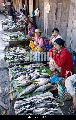 Burmese women selling fish at the Mingala Market. Nyaungshwe. Inle Lake. Myanmar - Stock Photo