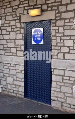 'FIRE EXIT KEEP CLEAR', emergency exit door. MORRISONS supermarket. The Old Showground, Kendal, Cumbria, England, - Stock Photo