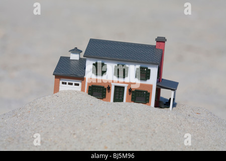 Only a foolish person would build a house on a weak sandy foundation - Stock Photo