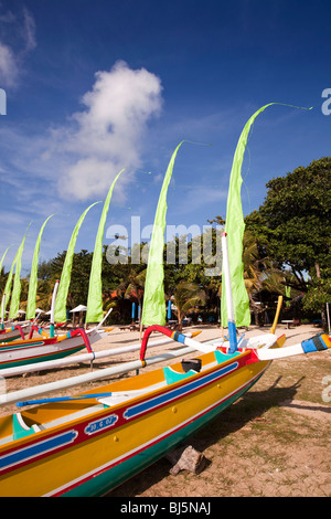 Indonesia, Bali, Sanur, colourfully painted outrigger fishing boats on the beach - Stock Photo