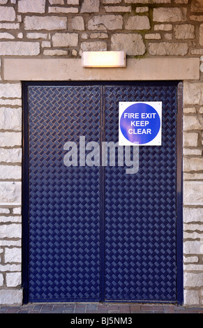 'FIRE EXIT KEEP CLEAR', emergency exit doors. MORRISONS supermarket. The Old Showground, Kendal, Cumbria, England, - Stock Photo
